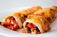 Vegetarian Black Bean Enchiladas - I know I've made these, but I honestly don't remember them. Still in search of a good low cal enchilada recipe to put in my dinner rotation. Veggie Enchiladas, Black Bean Enchiladas, Vegetarian Enchiladas, Cheese Enchiladas, Tostadas, Tacos, Mexican Food Recipes, Vegetarian Recipes, Cooking Recipes