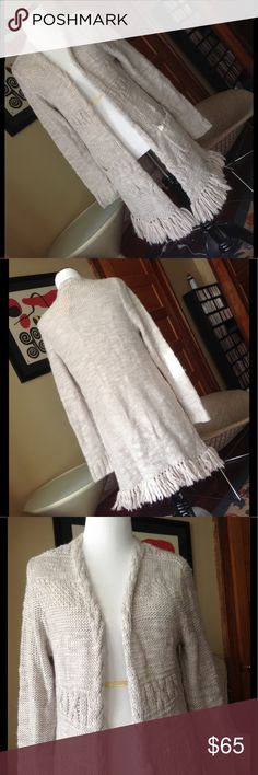 NWT Lucky Brand long fringed open cardigan NWT Beautiful oatmeal colored Lucky Brand open cardigan featuring fringes along the hem and front pockets.  Never worn, tags still on, brand new. Lucky Brand Sweaters Cardigans