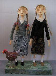 Sister folk art dolls with chicken cloth clay paint braids. $300.00, via Etsy.