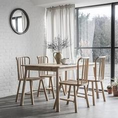 Our Scandinavian inspired Wycombe Dining Table works beautifully with our Wycombe Dining Chairs or Wycombe Dining Bench or a combination of both depending on your requirements. With its unique legs this piece will add style to your dining area.  Available in two sizes.  Match with other items in the Wycombe Range.  The brand new Wycombe Oak Furniture Range from Frank Hudson embraces the highest quality craftsmanship and on-trend design details. Crafted from the finest solid oak and selected…