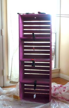 Bookcase/shelving unit made from wood crates, painted, poly'd, and glued together with Liquid Nails.