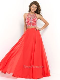 Both long and short two piece prom dresses are huge in the prom magazines this year! The Blush prom dress 9935 is a two piece evening gown that features a hand beaded rhinestone embellished crop top with a high neckline and a long chiffon skirt that adds elegance to this stunning prom dress! Features: Silhouette: Sheath Neckline: High Neck Fabric: Chiffon Sizes Available: 0 - 24 Colors Available: Persimmon Powder Blue Tangerine