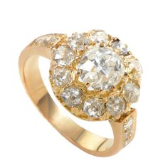 Edwardian Diamond Yellow Gold Cluster Ring. Edwardian jewelry is famous for its quintessential femininity and delicate motifs. This Edwardian ring is made of 18K yellow gold and features an ~1ct diamond main stone surrounded by a halo of white diamonds.