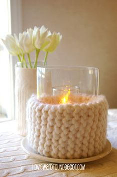 We love this idea.  Great Re-use item. Warm up your winter candles & flower vases with sweater wraps! Warm a modern home or use bright color sweaters for the holidays. Dollar store vases. Sweater wraps  from HOMEWARDfoundDecor.com, and tea light candles, votive candles and pillar candles in all holiday colors and sizes from BeverlyHillsCandle.com