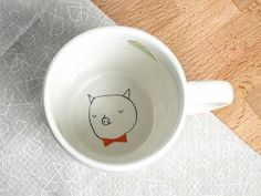 kimslittlemonsters etsy::small surprise at the bottom of a coffee cup