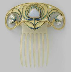 Fan shaped gold hair comb, each side curling in a spiral to end in a baroque pearl; sytlized enameled flower in the center. Possibly German or French, circa 1900-1910. From the Rijksmuseum in the Netherlands.