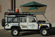 The most suitable place found for a tent - Defender 110 by Land Rover.