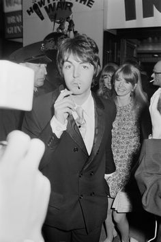"""littlequeenies: """" Paul McCartney and Jane Asher attend the premiere of the film 'How I Won The War', London, UK, 18th October 1967. Model Pattie Boyd is just visible between them. """""""