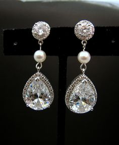 Bridal jewelry wedding jewelry bridal earrings wedding earrings clear white teardrop cubic zirconia round cz post round pearl connectors. $52.00, via Etsy.