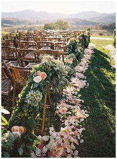 greenery and roses wedding aisle decor / http://www.deerpearlflowers.com/outdoor-vineyard-wedding-ideas/