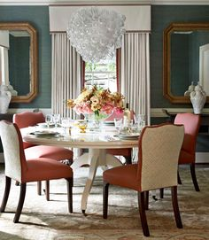 Dining room chairs with solid fabric on front and patterned on back -- I think I'd want them to be more closely related, but would be a very interesting detail, and a great way to make limited use of a more expensive fabric.