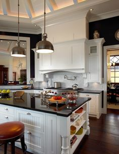 Dark Countertops  & Flooring Accent The Pops Of Color