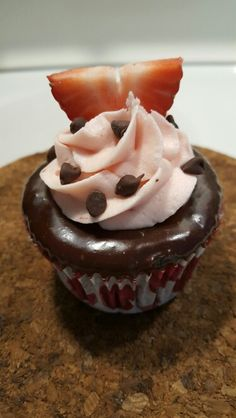 Chocolate Covered Strawberry Cupcake- chocolate cake, strawberry filling, chocolate ganache, strawberry icing, topped with mini chocolate chips and strawberry slice