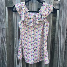 Liberty of London flower blouse SIZE: XS  MATERIALS: 100% polyester  DETAILS: in perfect condition, unbuttons in the front. Perfect for spring!  Pet and smoke free home! • Liberty of London  Tops Blouses