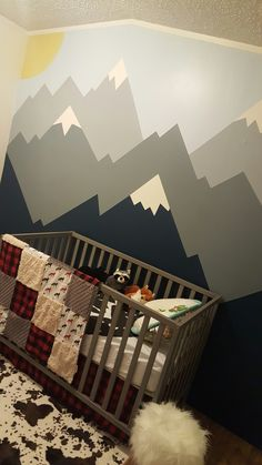Hand painted mountain mural in nursery.
