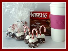 Candy Cane Stir Sticks. Stick a candy cane in a marshmallow, dip in melted chocolate & then crushed candy canes.