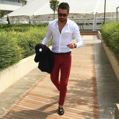 Tear your eyes away from the beautiful man for a moment and focus on the beautiful red slacks he's wearing so well. While worn by a man in this photo, images like this are still a springboard for inspiration. It's easy to imagine myself in a crisp white shirt of any design - tucked in, worn with a navy blazer or layered and worn open - paired with these fire engine red pants.