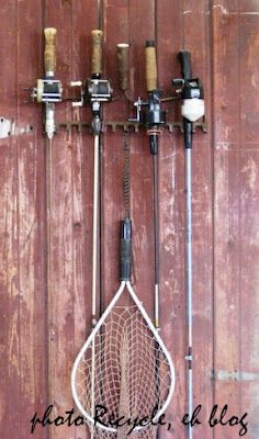 re-purposed old rake for hanging fishing rods