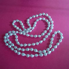 This long necklace is made of plastic pearl ( silvery / white ) nugget beads. by ThePemburyEmporium on Etsy