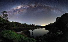 The Milky Way arches over a mirror-like lake on the island of Reunion. Luc Perrot waited two years before all the conditions were favourable for this photograph
