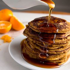 Made with coconut flour, these Paleo Pumpkin Pancakes have a bright note of citrus which beautifully compliments the earthy pumpkin and spices. #paleopancakes #glutenfreepancakes #glutenfree #paleo http://awholenewtwist.com/paleo-pumpkin-pancakes/