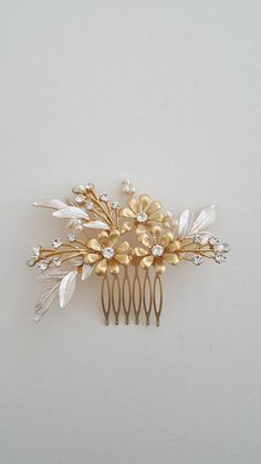GOLD FLORAL BRIDAL COMB  This comb has loads of pretty details with gold pearl finish olive branches,gold flowers and twigs of freshwater pearls and rhinestones. Works beautifully in almost any wedding hairstyle. Want more impact, try combining two of these combs in your hair. PLEASE NOTE: The photos of the model wearing this piece show this comb with pink enameled flowers, it is the same comb but with another finish option that can be purchased in different listing in my shop.   ♥ COLOR…