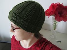 "This is a simple and quick knit using worsted weight yarn (sample in Cascade 220). It is knit bottom up and the finished product is very stretchy, fitting a wide variety of head sizes. The pattern is written using typical abbreviations and is laid out very clearly in round-by-round instructions. The main body is knit on 16"" circular needles, switching to double pointed needles once you are into the decreases. The gauge is measured in pattern, and should be 4 sts/inch."