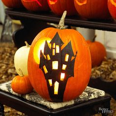 For some simple pumpkin painting ideas, chisel windows in a painted mansion and carve a moon behind. Candlelight from inside the pumpkin will bring the haunted scene to life.