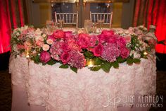 Beautiful pink sweetheart table at this Marbella Country Club wedding | Jim Kennedy Photographers