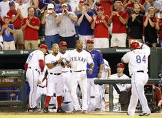 Texas Rangers second baseman Rougned Odor (12), Texas Rangers shortstop Elvis Andrus (1) celebrate a two run home run from Texas Rangers designated hitter Prince Fielder (84) in the eighth inning against the Houston Astros at Globe Life Park in Arlington, on Monday, September 14, 2015. (Vernon Bryant/The Dallas Morning News)