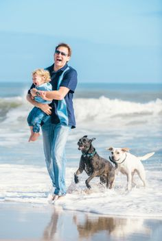 Dad with toddler son and dogs at the beach by David Walters Photography | Two Bright Lights :: Blog