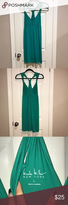 Nicole Miller Teal Stretch Jersey Knot Twist Dress Wonderful color and super comfy Nicole Miller Dress. Great teal color. **Shop my closet and bundle to save more, reasonable offers considered. Sorry not trading at this moment ** 💜💕💜POSH AMBASSADOR 💜💕💜 Nicole Miller Dresses