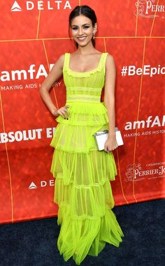Victoria Justice from 2018 amfAR Gala Los Angeles: Red Carpet Fashion  Bold and beautiful! The actress donned a slightly see-through bright yellow, chiffon dress, which she matched with a white clutch.