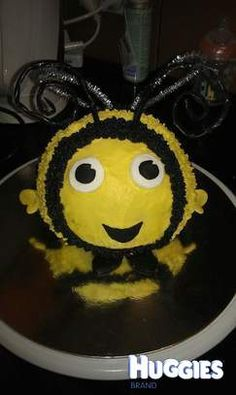 I made Buzzbee from the kids show The Hive.  My son turned 2 on July 19 and absolutely loves that show so i decided to make that cake for his party. I hired a sports ball cake tin to get the round shape then iced it yellow, made the eys, hands and feet from rolled fondant icing and stuck them on the iced cake before it set, then piped the stripes on bee with the star tip and used pipe cleaners for wings and antennae.