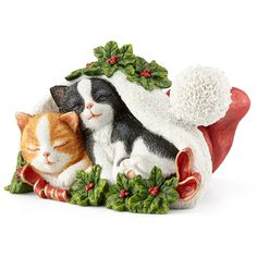 """2016 Christmas Cat Nap Figurine by Lenox Snuggled together in a festive Santa Claus hat, 2 kittens are portrayed in the 2016 Christmas Cat Nap Figurine. Crafted of artist's resin and beautifully painted by hand, this wonderful figurine makes a fun gift for cat lovers everywhere. Crafted for Christmas 2016 only •Crafted of hand-painted artist's resin •Created exclusively for 2016, quantities limited •Height: 2 1/2"""" •Width: 4"""""""