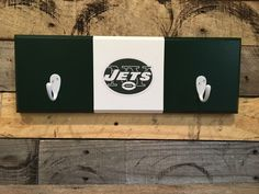 A personal favorite from my Etsy shop https://www.etsy.com/listing/468734276/new-york-jets-2-hook-hat-coat-rack