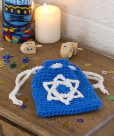 Gift of Gelt Bag Crochet Pattern ~ Delight your little ones with this crocheted bag, ready to fill with gelt for their Hanukkah celebration.