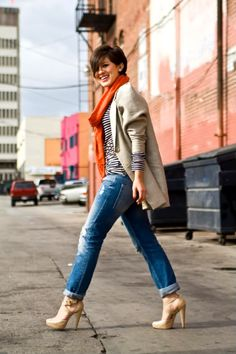 I imagine her living in Seattle - a jacket to keep warm, and heels to keep the pants out of puddles!
