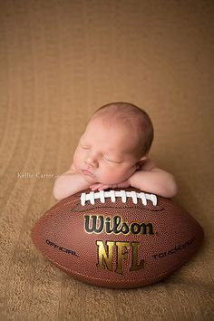 cute baby picture with a football