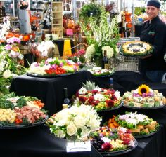 Purchase fruit and vegetable trays adorned with fresh flowers.