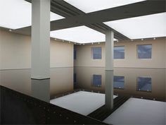 Richard Wilson's permanent installation at the Saatchi Gallery is far more impressive in person.  The black reflective surface is oil. So cool!