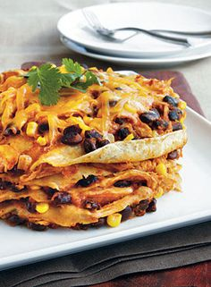 "Recipe for Slow Cooker Chicken Enchilada Stack - Think outside the ""dish."" You can enjoy the flavor and texture of enchiladas in a slow cooker; just stack the tortillas instead of rolling them. We suggest lining your slow cooker with a slow-cooker bag so you can easily remove the stack from the cooker."