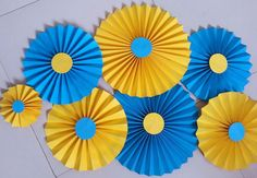 Yellow And Blue Paper Rosettes/Fans/Pinwheel backdrop by craftacea
