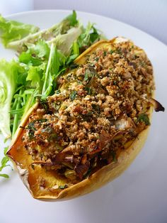 Stuffed Butternut Squash    http://girlinterruptedeating.wordpress.com/2009/12/06/stuffed-squash/