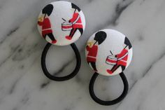 British Marching Soldiers pony tail holders make by Baby Raindrops, $5.95 at www.babyraindrops.etsy.com.