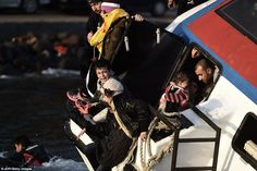 Sorrow: One young boy screams and cries in terror as the boat wildly rocks in the strong c...