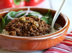 Crock Pot Picadillo -- very tasty in burritos! next time chop the olives and add more of them, use homemade tomato sauce, use more peppers.