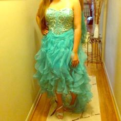 Homecoming/Prom evening dress Beautiful teal high low dress with corset back. Crystal bodice and back. Slits in the back makes the ruffles sway as you walk. Bra within the dress. Dress was purchased in California. Dresses Prom