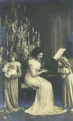 Late 1800s Christmas ...mother at the piano with her daughters