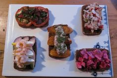 Danish Smørrebrød | Danish food culture is all about rye bread, and smørrebrød, open-faced sandwiches, are the most popular way to enjoy it. Smørrebrød are made with a slice of rye bread topped with meat, fish or vegetables and different spreads. There are lots of understood rules about what to combine and what not to — some are […]